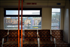Overground in East London (Sven Loach) Tags: uk travel windows england orange streetart motion london buildings print graffiti nikon view britain empty bricks victorian retro journey seats shoreditch type hackney publictransport tagging overground eastlondon tfl terracedhouses klep d5100