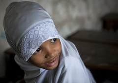 Young Girl Wearing White Hijab Veil In The Classroom Of Stonetown Academy Lamu, Kenya (Eric Lafforgue) Tags: africa school portrait color cute beautiful beauty childhood horizontal island photography kid education pretty child kenya interior muslim islam hijab culture unescoworldheritagesite indoors afrika tradition lamu swahili afrique eastafrica qunia lamuisland lafforgue traveldestination africanethnicity onegirlonly  qunia islamicveil  onechildonly   kea   tradingroute blackethnicity a 122664