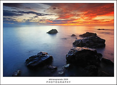 Blue Heaven Vs Red Hell (ali trisno pranoto) Tags: longexposure sunset red seascape indonesia rocks waterscape ternate malukuutara northmaluku alitrisnopranoto