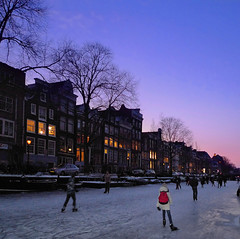 Amsterdam Ice-skating by night (Bn) Tags: pink blue houses winter people cold holland ice netherlands dutch amsterdam night geotagged lights frozen twilight topf50 downtown iceskating skating joy kinderen nederland freezing first romance skaters canals age skate romantic prinsengracht temperature topf100 mokum occasion rare grachten pleasure skates blades winters stad harsh jordaan 2012 d66 ijs gluhwein schaatsen koud amsterdamse ijspret hendrick chocolademelk grachtengordel hollandse oudhollands 100faves 50faves gekte winterse sferen avercamp ijzers ijsplezier geo:lat=52365292 jordanezen ijsnota geo:lon=4884080