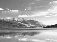 Loch Etive: Perfect Moment (spodzone) Tags: camera longexposure light sunset sky blackandwhite sunlight mountains reflection art nature monochrome beautiful lines weather clouds point landscape scotland highlands still warm raw horizon memories gimp sunny places calm filter zen vista rest beyond serene moment idyll awe striking simple toned pure contrasts tranquil airy contentment elegance glenetive sidelit circularpolariser sumptuous nearfar digikam lochetive landwater bencruachan olympuspenf skyearth warmcold shapeandform rawconversion 1260mm rawtherapee calmstill lochshore statesofwater darktable digitalgradnd digitallowpass