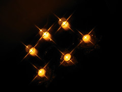 ...night vision... (carbumba) Tags: yellow blackbackground fire gold candles glow candle flame
