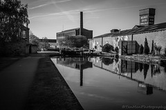 Canal Mills (jasonmgabriel) Tags: chimney bw white reflection building mill water monochrome canal leeds towpath nlack