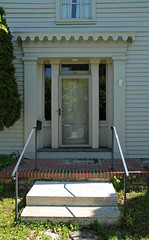 Doorway, Thomas Orr House  Troy, Ohio (Pythaglio) Tags: county door wood ohio house brick museum greek weeds miami thomas gothic steps entrance troy frieze historic doorway hedge frame restored siding residence stoop railings orr entry 1854 transom capitals cornice architrave dwelling revival pilasters transitional fourpanel sidelights trabeated mia825
