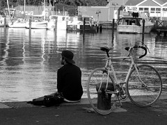 Short Break At The Fjord (yantrax) Tags: city portrait people urban blackandwhite man water monochrome bicycle reflections germany boats boat town ship outdoor sony ships citylife scene shore fjord flensburg einfarbig streetphotographie
