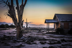 farmhouse past (Karol Franks) Tags: california county sunset abandoned farmhouse losangeles desert dry socal porch lancaster antelopevalley deserted deadtrees