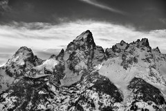 Jagged Peaks of the Teton Range (Black & White) (thor_mark ) Tags: day2 mountains nature blackwhite unitedstates moose wyoming grandteton snowylandscape lookingwest tetonrange grandtetonnationalpark project365 mountowen middleteton colorefexpro teewinotmountain ushwy89 mountainsindistance blueskieswithclouds roadsidepulloff silverefexpro2 nikond800e mountainsoffindistance capturenx2edited triptoidahoandgrandtetons greateryellowstonerockies tetonrangeyellowstonearea