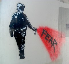 Fear (TheBrainDead) Tags: street red color art beautiful minnesota wall america john dead pepper photography graffiti freedom high amazing cool nice riot interesting stencil paint flickr good quality awesome fear protest cities free minneapolis police twin brain spray event most donut cop hate neat pike uc davis obama current brutality berkley the braindead inome flickrs occupy thebraindead