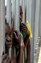 Tower Fence (cowyeow) Tags: poverty africa friends boy boys students strange kids children fun weird student sad african poor young prison together jail uganda primary kilembe