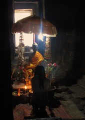 a moment of faith (rpiker101) Tags: umbrella dark temple shrine asia cambodia candles angkorwat buddah angkorthom