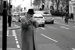 walking stick gun (Paul Steptoe Riley) Tags: uk england urban blackandwhite streets male london public monochrome westminster photography britain candid streetphotography documentary victoria pimlico blackandwhiteurban paulsteptoerileyportfolio