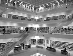 Paradise for Bookworms - New City Library (Batikart ... O F F !!!) Tags: city autumn light people urban blackandwhite bw white black reflection building window public glass lamp lines wall architecture modern stairs canon germany buch geotagged deutschland book lampe licht blackwhite europa europe doors pattern floor stuttgart geometry interior library wand bibliothek steps books bookshelf menschen line shelf treppe stadt architektur sw schwarzweiss weiss 500faves spiegelung gebude schwarz glas regal bcher mensch g11 citylibrary badenwrttemberg swabian bcherei 2011 100faves ffentlich 200faves viewonblack 300faves 400faves batikart canonpowershotg11 stadtbibliothekstuttgartyiarchitects