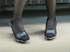 extended toes (Samm Bennett) Tags: japan train person foot shoe tokyo rail aboard