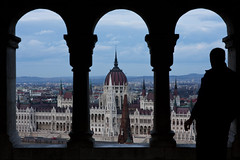 Smoking with a view (Crazy Ivory) Tags: blue shadow sky black building silhouette architecture standing canon dark person high interesting hungary arch dusk hill gothic budapest parliament arches smoking duna parlament danube fishermansbastion canon24105mmf4lisusm canonef24105mmf4lisusm canon24105mm canoneos40d canon24105mm40lisusm gettygermanyq4