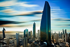 Kuwait - Al Hamra Tower & city (Abdulaziz ALKaNDaRi | Photographer) Tags: world morning blue color colour speed skyscraper canon lens landscape outdoors photography eos rebel high aperture exposure downtown photographer gulf view shot quality east iso explore photograph arab commercial trading arabia kuwait arabian hq middle scape length ef 1740 2012 sculpted burj q8 برج tallest focal kwi مدينة الكويت abdulaziz عبدالعزيز كويت kuw 550d q8city الشرق منطقة المصور t2i الحمره arabgulf kesslercrane الكندري alkandari sharaq تجاريه blinkagain abdulazizalkandari wearab