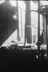 Silhouette (RLGarlick) Tags: door blackandwhite bw analog 35mm iso400 stlouis chain missouri 35mmfilm traincar agfa museumoftransportation printfilm rangerfinder bwnegative agfasilettei silette1 35mmrangerfinder fourcornersbwfilm