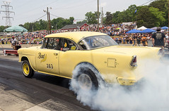 "The ""Bad Banana"" '55 Chevy gasser laying down some rubber (Thumpr455) Tags: auto classic chevrolet car sport yellow speed vintage nikon automobile smoke traditional bowtie nostalgia chevy autoracing burnout 55 dragracing gasser d800 straightaxle badbanana greerdragway afnikkor1635mmf4vr southeastgassers southcarolinaapril2016"