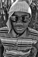 Ray Bans (alisdair jones) Tags: africa boy wool hat sunglasses tribe namibia himba ef35mmf14lusm