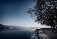 i dreamt i went to ioannina (helen sotiriadis) Tags: blue trees sky lake seascape black water canon landscape published waterfront greece curve canonefs1022mmf3545usm ioannina canoneos40d