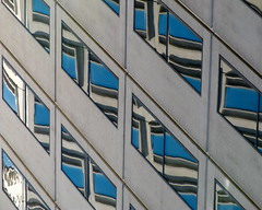 Merit Badge (Dialed-in!) Tags: city blue windows urban reflection building vertical oregon portland downtown angle or diagonal repetition pdx dialedin