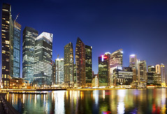 Singapore Marina Bay (Kenny Teo (zoompict)) Tags: blue light sunset seascape reflection building tourism beautiful marina sunrise canon wonderful landscape bay photo yahoo google scenery photographer waterfront walk tourist best getty kenny marinabay singaporemarinabay zoompict