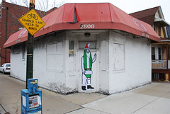Santa Banana (Left Handed Wave) Tags: park santa street new red holiday chicago man building brick green art shirt print graffiti illinois stencil holidays paint gallery paste wheat tag parking wave screen banana spray suit ave installation graff left streetsy sleigh tagging handed clause diversey