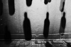 Floating Bottles @ Bar Betta, Hanoi (чãvìnkωhỉtз) Tags: blackandwhite bw bar lumix wire raw shadows bottles artistic vietnam hanging suspended hanoi 2011 việtnam hànội lx5 barbetta badinh quận bađình gavinkwhite