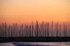 Romantic [Explored] (Gaby.Bernstein) Tags: sunset sea water night port boats harbor marine couple waves gaby dusk sails clear shore bernstein bernsteingaby gabybernstein