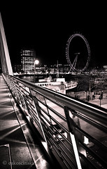 London in 2011 (eakoscinska) Tags: bridge blackandwhite london wheel night lights centre londoneye