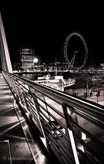 London in 2011 (eakoscinska) Tags: bridge blackandwhite london wheel night lights centre londoneye