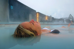 Relaxing in Blue Lagoon - Iceland (LimeWave Photo) Tags: blue sky woman snow hot ice water iceland relaxing floating lagoon geothermal seawater snowclad