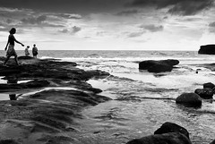 on the rocks (Josh RCG) Tags: ocean sea bw bali cloud beach water clouds walking indonesia rocks lot overcast tanahlot tanah