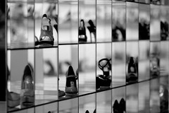 Shoe Fortress (Universal Stopping Point) Tags: mall bahrain shoes highheels dof display squares mirrors reflective heels manama