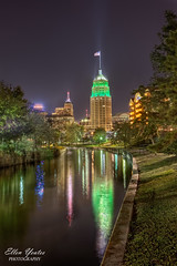 Tower Life Building Reflection at Riverwalk (Ellen Yeates) Tags: christmas light sky reflection building green tower night work canon river photography hotel ellen san texas flag an antonio hdr riverwalk yeates touristholiday