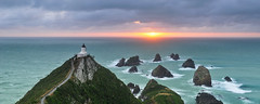 First Light (Mike Isaak) Tags: ocean blue trees newzealand panorama orange lighthouse green nature water yellow clouds sunrise landscape photography coast solar amazing nikon rocks photographer hiking pano naturallight panoramic hike otago coastline filters epic hdr fineartphotography waterscape nuggetpoint solarpowered godlight travelphotography gnd nuggetpointlighthouse d300s mikeisaak wwwmikeisaakcom