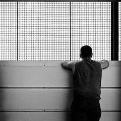 Jail (christian.senger) Tags: shadow portrait people blackandwhite white man black 6x6 film tattoo rollei analog rolleiflex fence mediumformat geotagged grid grey kodak outdoor gray squareformat sl66 lightroom carlzeiss silverfast photostudio13 gettygermanyq4 christiansenger:year=2012