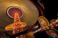 The Zephyr Vortex... (Ring of Fire Hot Sauce 1) Tags: longexposure light reflection night disneyland spinning mickeymouse disneycaliforniaadventure swirlinglight paradisepier goldenzephyr mickeysfunwheel