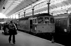 London Victoria Station January 1976 (loose_grip_99) Tags: railroad london station electric architecture train blackwhite br diesel noiretblanc transport victorian engine rail railway trains victoria multiple emu locomotive railways britishrail trainshed unit britishrailways lbscr class33