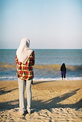 """""""Don't walk behind me; I may not lead. Don't walk in front of me; I may not follow. Just walk beside me and be my friend."""" -  Albert Camus (asuramaru) Tags: beach 50mm fuji minolta superia hijab analogue pcb 2012 x700 rokkor 17"""