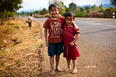 Friends (Bastiaan Schuit) Tags: road travel portrait kids canon southeastasia tour barefoot laos bolavenplateau