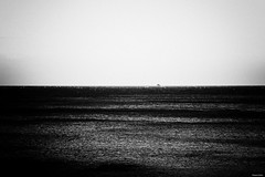 remembering |coal series| (Nassia Kapa) Tags: sea blackandwhite music sun cold contrast dark mono marine solitude poem noir mare waves mood loneliness view artistic wind air horizon memories grain dream dramatic surreal jazz atmosphere mani surface poetic symmetry minimal line greece simplicity reality isolation feeling presence simple powerful plain nero nn filmnoir kapa nassia deepbluesea gerolimenas nassiakapa coalseries apsence