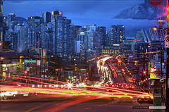 When The Lights Go Down In The City [Explored] (Clayton Perry Photoworks) Tags: vancouver night lights traffic street trails skyline waynesweatherwindow global tv bc explore explored