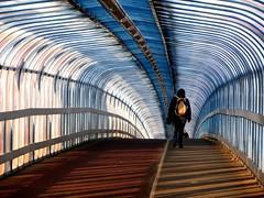 Crossing Carter Bridge (shaggy359) Tags: bridge blue cambridge shadow woman freeassociation lines walking shadows bend footbridge walk hill pedestrian line carter rucksack cambridgeshire cambs carterbridge tonycarter