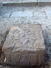 Carved stone decorated with menorah (© Moshe Hartal, Israel Antiquities Authority)