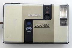 Konica AA-35 (pho-Tony) Tags: film analog 35mm gold drive miniature flat champagne frame half motor konica analogue 24mm halfframe sliding f4 18x24 brushed autofocus hexanon motordrive photosofcameras konicaaa35 aa35 konicahexanon automaitc 18mmx24mm