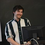 A student smiles during his capstone presentation