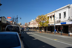 Blue Skys (Jocey K) Tags: street autumn trees newzealand sky people cars lamp architecture buildings shadows shops timaru southcanterbury staffordst tripdownsouth