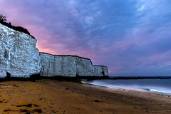Magnificent Sky over a sandy bay (Tiffany - Angle Eaton) Tags: longexposure pink sunset sea beach water beautiful night canon landscape photography evening coast still sand purple calm cliffs colourful seafront evenings beachphotography 1200d canonofficial