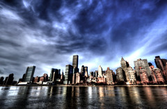 Dramatic Sky above Midtown, Manhattan (Yohsuke_NIKON_Japan) Tags: nyc sky usa cloud newyork clouds nikon manhattan sigma midtown unitednations eastriver  rooseveltisland hdr  10mm  photomatix colorefex    trumpworldplaza d3100