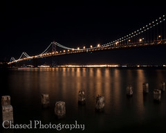 Bay Bridge Night Life v2 (ChasedPhotography) Tags: ocean california longexposure bridge water night lights bay pier baybridge embarcadero bayarea sfbayarea sffd suspensionbridge fireboat sanfransisco